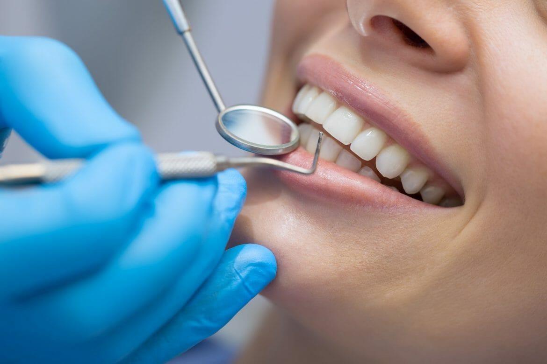 Woman getting teeth cleaning